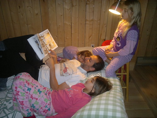 Reading Bones before bed by ngoldapple