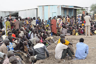 Victims of ethnic violence in Jonglei state in South Sudan wait in line at the World Food Program distribution center in Pibor to receive emergency food rations, last week. by Pan-African News Wire File Photos