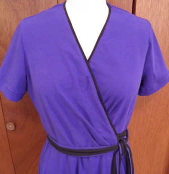 closeup of front of purple knit dress