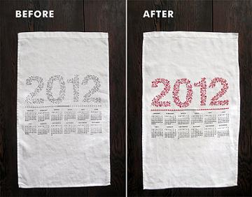 Before and after photos of a 2012 calendar on a white tea towel. The before picture shows a calendar with 2012 printed across it in black ink, with the months laid out below in black ink. The after picture shows 2012 after someone has embroidered flowery patterns over the 2012 text with red embroidery thread.