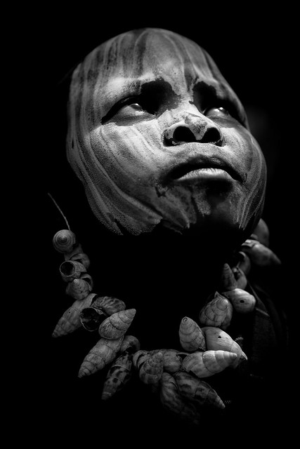 Mursi tribe child with face painted