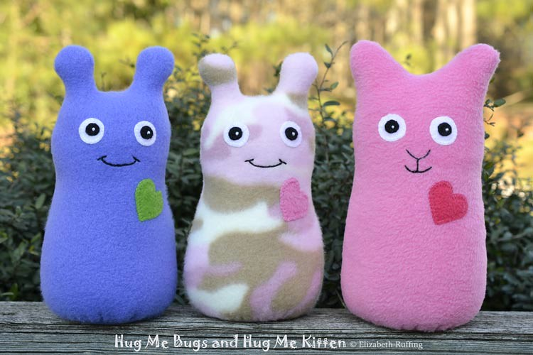 blue and pink camouflage fleece Hug Me Bugs, medium pink fleece Hug Me Kitten original art toys by Elizabeth Ruffing