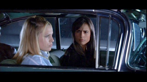 D.E.B.S. Sara Foster and Jordana Brewster share a moment in a car.