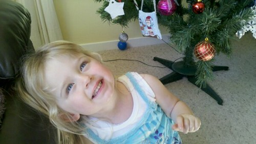 My niece and her Christmas ornament :-)  I think she looks fairly pleased with it!