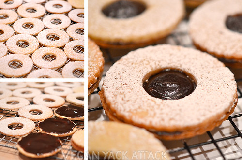 Chocolate linzer cookies being put together on a cooling rack