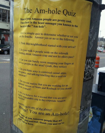 amhole, protest flyer against Amazon workers, Seattle
