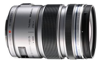 12-50mm, 4.2x zoom, 3-speed motorised zoom mechanism, MSC mechanism for foast, quiet AF, stop focus and macro magnification at 0.72x (35mm equiv), dust/splash proof.
