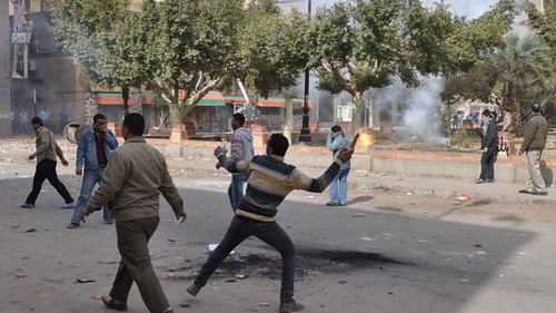 Egyptians clash with authorities in Suez amid anger over the deaths of 74 people at a soccer match in Port Said on February 1, 2012. Many people blamed the military for the deaths. by Pan-African News Wire File Photos