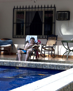 Patrick reading by the pool (photo: Rick Brazeau) | by Endymion Studios