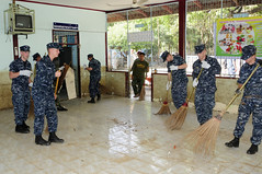 LOPBURI, Thailand (Nov. 20, 2011) Sailors from USS Lassen (DDG 82) sweep mud and debris from a cafeteria during a community service project at Watsanamchai Temple School. (U.S. Navy photo by Mass Communication Specialist 1st Class Johnie Hickmon)