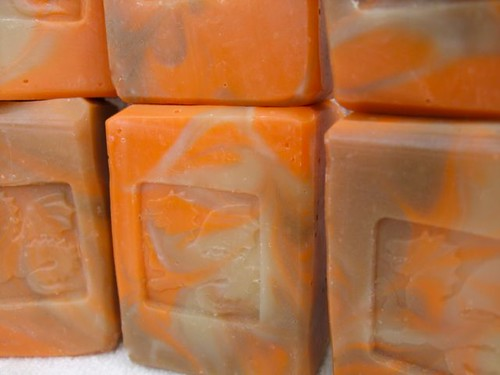 orange and brown swirled soaps with dragon stamps