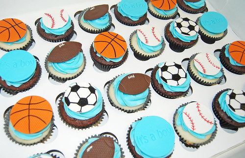 Its a boy sports themed baby shower cupcakes - football, soccer, baseball, basketball