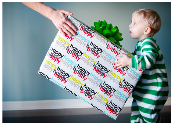 Toddler receiving his big gift for his birthday in Belair, Maryland during their holiday photography session. Taken by Benson Lau Photography.