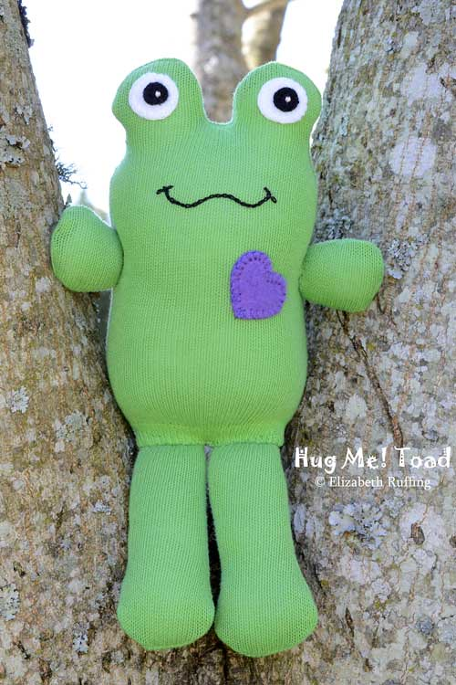 Green Hug Me Toad, sitting in a tree, original sock doll art toy by Elizabeth Ruffing