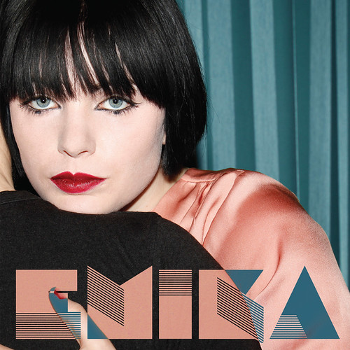 Emika, album cover—A white woman with black hair looks at the camera over someone's shoulder