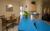 <p>Kitchen and Nook area leading to pool</p>