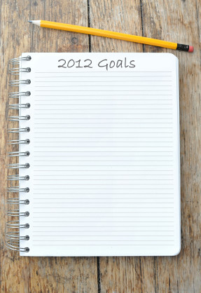 "Spiral notebook with ""2012 Goals"" written at the top by Pearson School Systems"