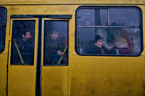 winter reflection window grit candid streetphotography ukraine stare bleak kyiv commuters yellowbus trolleybus gritandgrain thomdavies