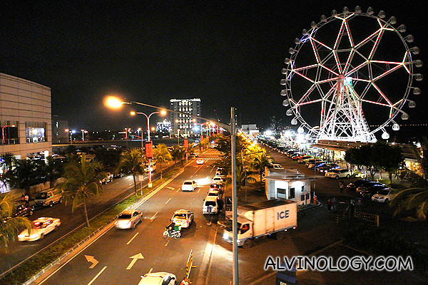 SM Mall of Asia on the left and Manila Bay on the right