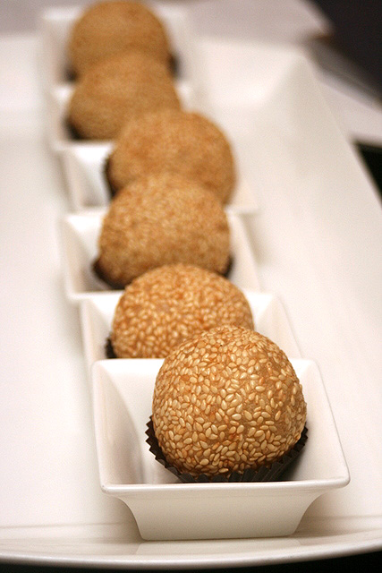 Sesame coated glutinous rice balls with red bean paste and champagne