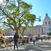 Flea market in Lisbon backgrounded by the National Panteon