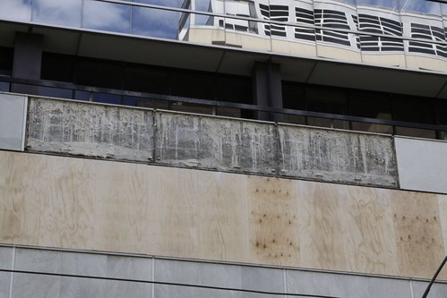 Removed marble panels on the Flinders Lane frontage of 447 Collins Street - intentionally removed, not fallen off