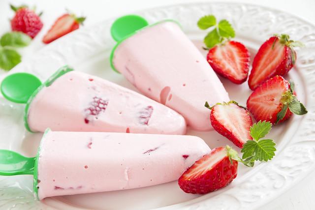 Homemade strawberry ice cream with fresh berries.