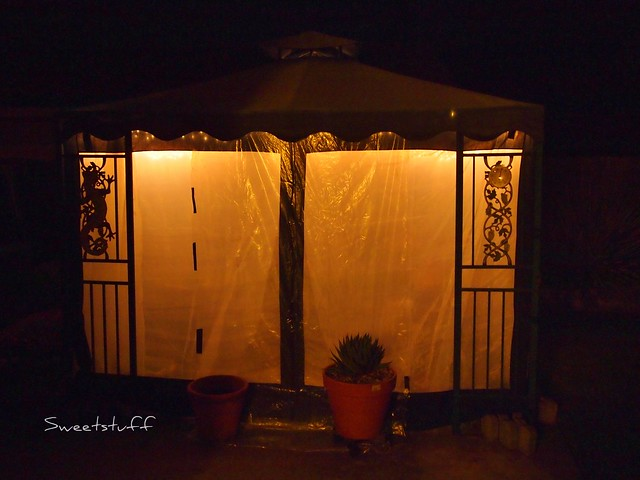 My glowing gazebo greenhouse at night