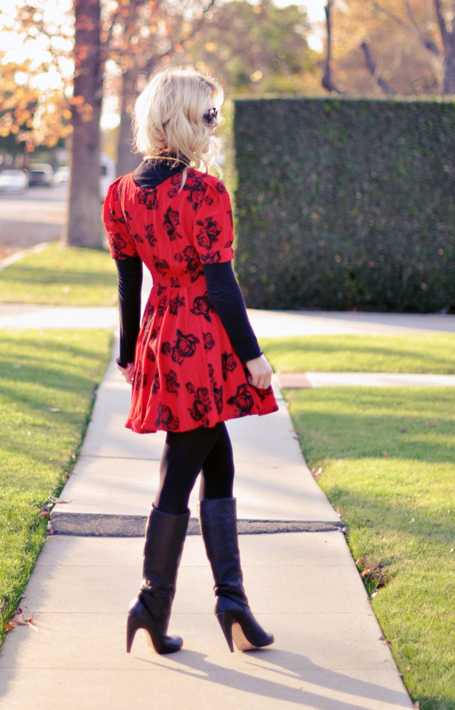 hair tucked in turtleneck - red dress - boots