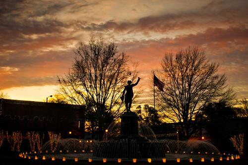 christmas trees sky water fountain silhouette statue clouds sunrise georgia flag christmaslights usflag lafayettesquare lagrange troupcounty thesussman sonyalphadslra550
