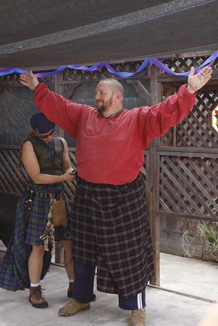 Kilting the officiant.