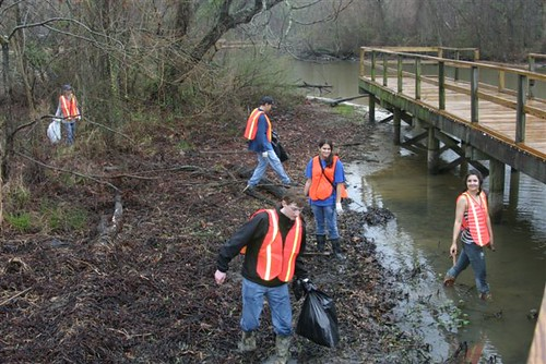 Earth Team volunteers clean up a creek along the Reservoir as part of the Great American Cleanup in March 2011.
