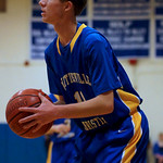 "Whitinsville Christian 85, Hopedale 63: Undermanned..By Jared Keene/Daily News staff..At 6-foot-6, senior Paul Manning is the main rebounder and inside threat on Hopedale's boys basketball team...Just 2:25 into last night's contest with Dual Valley Conference rival Whitinsville Christian, however, Manning picked up his second foul, earning him a spot on the bench for the rest of the half...The Crusaders took full advantage, out-rebounding the hosts by 18 in the first half while lighting it up from the field in a 85-63 victory...""If I didn't get those silly fouls at the beginning of the game, I felt like I would have played the whole first quarter, so that alone would have kept the rebounding up to par with the other team,"" Manning said. ""We wouldn't have been down so much.""..Hopedale coach Tony Cordani saw a variety of factors key the visiting Crusaders...""They came ready to play and I don't know what their percentage was in the first half, but they shot the ball extremely well,"" said Cordani after his team fell to 6-3 (2-1 DVC). ""And Paul got into a little foul trouble, so we couldn't rebound with them. The combination of their exceptional shooting in the first half and our lack of rebounding was the difference, I thought.""..Whitinsville Christian seemed to set the tone early by forcing a turnover and an airball on the Blue Raiders' first two offensive possessions...The Crusaders held a 19-9 lead after the first quarter, thanks in large part to their eight offensive rebounds — allowing for second-chance opportunities — and tough man-to-man defense that seemed to fluster the Hopedale offense...""One of our keys to the game was to win the rebounding battle tonight and keep them off the offensive glass and for the most part we did a pretty good job of that,"" Whitinsville coach Jeff Bajema said. ""We've also been working hard on our defense. We don't have the height this year, but we've got some quick guards and kids that like to defend. That's our game right now.""..In the second quarter, the Crusaders also started taking advantage of the various zone defenses the Blue Raiders played. Whitinsville Christian spread the floor and used quick, crisp ball movement to end up with numerous open 3-pointers...Of the seven triples the Crusaders hit for the game, five came in the second quarter, a period in which the visitors built their lead to 25 by halftime (50-25). Two of those five treys came from the hand of Colin Richey, who finished with a game-high 20 points...""I've seen these guys play on a number of occasions and the teams that have gone man-to-man (against them), Richey has been able to penetrate and then he becomes a problem,"" Cordani said of the decision to play zone. ""I was just hoping that we could weather the storm a little bit and have some in the tank at the end. It was a gamble we took. I guess we'll see what happens next time we play them.""..Hopedale came out a different team in the third quarter, out-rebounding Whitinsville by six while outscoring the Crusaders 22-12 to pull within 62-47...Just 15 seconds into the fourth quarter, the Blue Raiders cut the lead to 13, but that was the closest they got the rest of the way, as Whitinsville used a 14-4 run to take its lead back up to 23 at 76-53 and ice the game...--------------..Colin Richey led all scorers with 22 points, including two 3-pointers for the visiting No. 9 Crusaders (4-1, 3-0 Dual Valley). Tyler VandenAkker added 15 points, and Antonio Estrella scored 12 for Whitinsville Christian. Jeremy Bacon's 15 points paced the Blue Raiders (6-3, 2-1). ..WHITINSVILLE CHRISTIAN.Name.FGM.3PM.FTM.Pts..Tim Dufficy.4.2.0.10.Eric Monroe.1.1.0.3.Connor Dolan.2.0.0.4.Scott Ebbeling.1.0.1.3.Jesse Dykstra.4.0.0.8.Antonio Estrella.6.0.0.12.Colin Richey.8.2.4.22.Grant Brown.3.2.0.8.Tyler VandenAkker.7.0.1.15.Totals.36.7.6.85..HOPEDALE.Name.FGM.3PM.FTM.Pts..Colby Caso.1.0.0.2.Cole Dedonato.0.0.0.0.Shane Finnegan.2.2.0.6.Kevin Lynch.4.1.0.9.Evan Lerner.2.0.2.6.Ian Strom.4.1.0.9.Dan Manoli.1.0.0.2.Paul Manning.4.0.1.9.Jeremy Bacon.3.0.9.15.Nick Walker.2.1.0.5.Totals.23.12.12.63.  Shot at ISO 3200, Aperture of 2.8, Shutter speed of 1/400 and Focal Length of 80.0 mm Taken with a Minolta/Sony AF 70-200mm F2.8 G lens and processed by Aperture 3.2.2 on Monday January-09-2012 21:10 EST PM"
