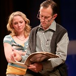Art collector Daniel (Bruce McKenzie) reviews Sarah's (Therese Barbato) sketches in the Huntington Theatre Company's production of