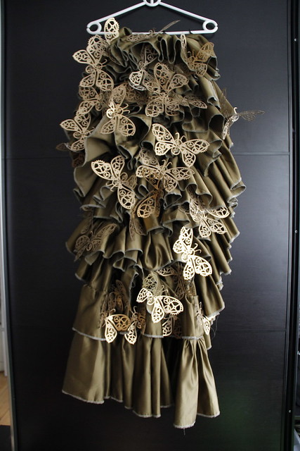 Laser cut butterflies with gears in ruffle skirt
