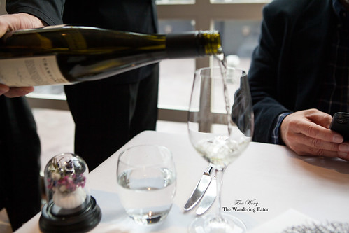 W checking his phone whilst getting his Riesling poured