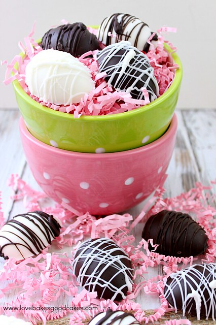 Peanut Butter Easter Eggs laying in a green bowl and in front of the bowl with pink confetti.