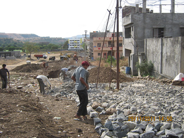 Under construction 21 feet wide tar road to Urbangram Kirkatwadi, A 2 BHK Flat for Rs. 25 Lakhs on Sinhagad Road, Pune 411 024