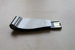 hand(0.0), electronic device(1.0), data storage device(1.0), usb flash drive(1.0),