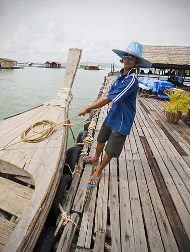 Boatman at the floating restaurant