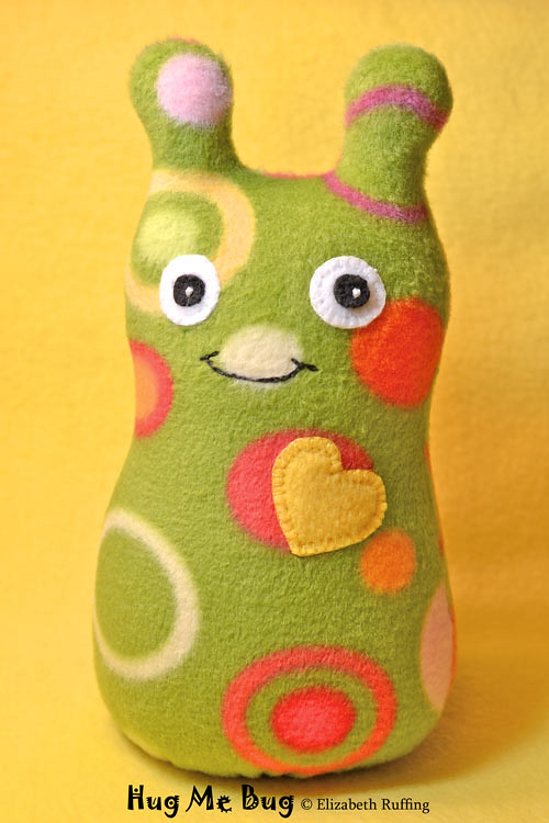 Green polka dot fleece Hug Me Bug, original art toy by Elizabeth Ruffing