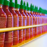 Sriracha Sauce lined up at ShopHouse Restaurant 2