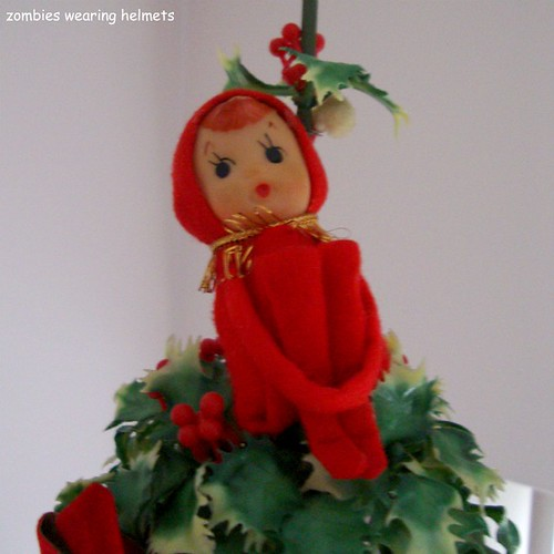 Elf on a bell made of holly