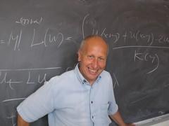 Luis Caffarelli y Michael Aschbacher, Premio Wolf de Matemáticas 2012
