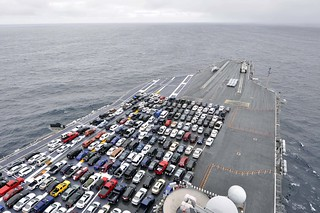 The aircraft carrier USS Ronald Reagan transports Sailors' vehicles.