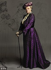 Violet Grantham in a purple dress and hat