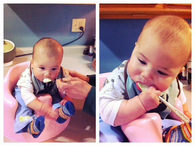 Six months old, trying out his first food: rice cereal.