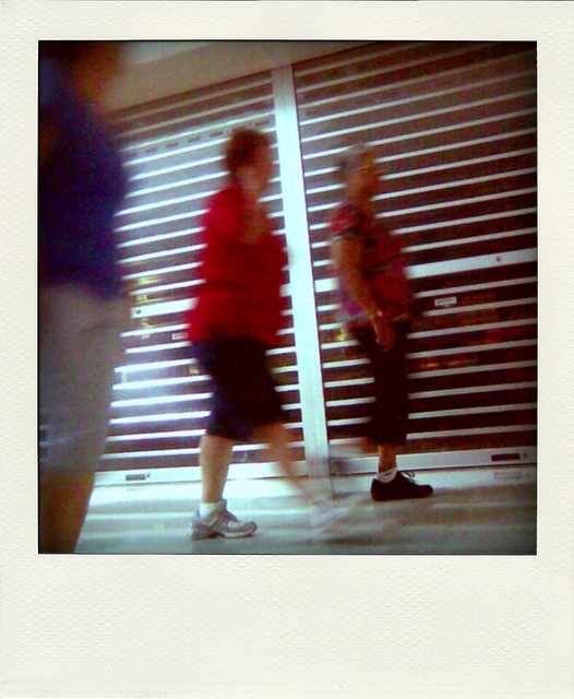 Old men walk in shopping mall #5