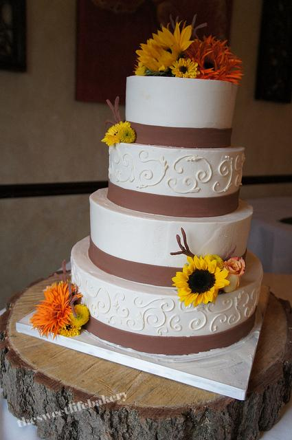 This fall themed wedding cake has a simple fondant band with a few fondant