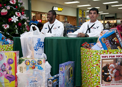 Sailors accept donations for the Toys For Tots toy drive.